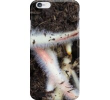 Macro photo of roots in brown garden soil. iPhone Case/Skin