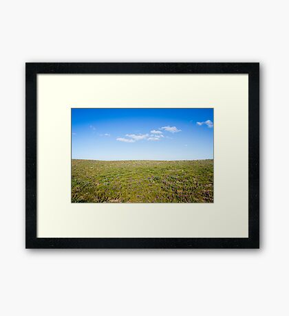 Hills with field of flowers Framed Print