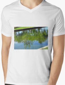 Trees reflected in the water in the park. Mens V-Neck T-Shirt