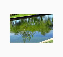 Trees reflected in the water in the park. Unisex T-Shirt
