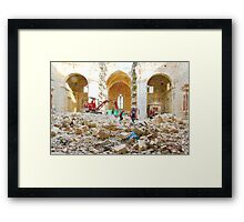 L'Aquila: collapsed church with digger wheelbarrow and rubble Framed Print