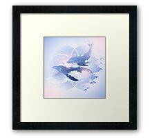 Graphic whales flying in the sky Framed Print