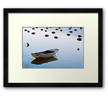 Water mirror and a small boat Framed Print