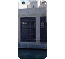 Building by the water with metal protection. iPhone Case/Skin