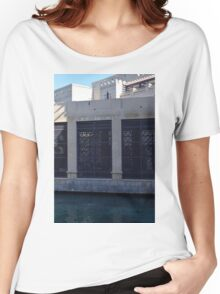 Building by the water with metal protection. Women's Relaxed Fit T-Shirt