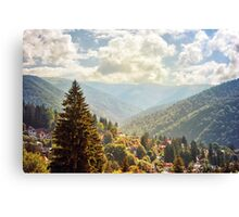Fantasy scenery with mountains and cloudy sky. Canvas Print