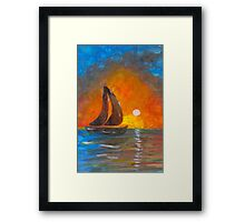 A boat sailing against a vivid colorful sunset  Framed Print