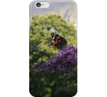 Red admiral on rose bay willow herb, backdrop of Exmoor coastline. iPhone Case/Skin