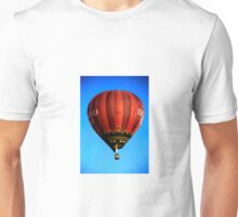 Red hot air balloon in flght on blue sky. Unisex T-Shirt