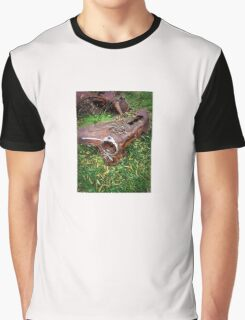 Rusted car fender laying in junk yard Graphic T-Shirt