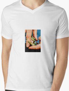 Green bush frog hanging onto finger Mens V-Neck T-Shirt