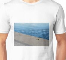 Ripples in the blue water. Unisex T-Shirt