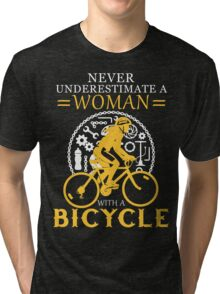 Never underestimate a bicycle woman Tri-blend T-Shirt