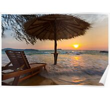 Empty beach with straw umbrella on sunrise Poster
