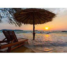 Empty beach with straw umbrella on sunrise Photographic Print