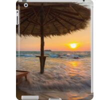 Empty beach with straw umbrella on sunrise iPad Case/Skin