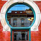 Reflections in a Wheeling Window by Bryan D. Spellman