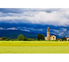 Evening storm over the medieval village Photographic Print