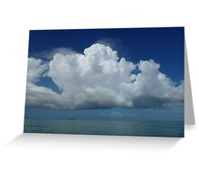 Fluffy clouds over the water Greeting Card