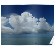 Fluffy clouds over the water Poster