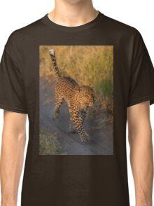 Leopard running along sandy track in grass Classic T-Shirt