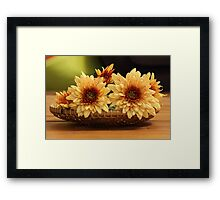 Orange chrysanthemums on a bamboo basket Framed Print