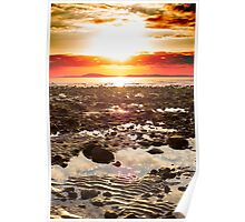 red reflections at rocky beal beach Poster