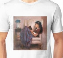 Portrait of woman reading a book in a comfy chair Unisex T-Shirt