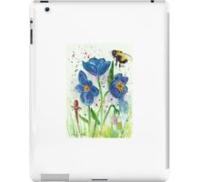 Bumble bee among blue poppies iPad Case/Skin