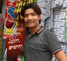 Retailer at Begum Bazaar Hyderabad by Andrew  Makowiecki