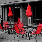 Red Chairs And Umbrella by Rodney Williams