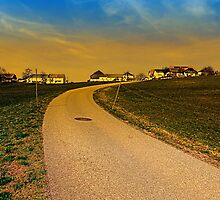 A road, a village and a sunset | landscape photography by Patrick Jobst