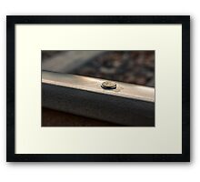 Coin on a chewing gum sticked to the railroad Framed Print