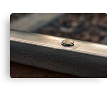 Coin on a chewing gum sticked to the railroad Canvas Print