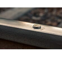 Coin on a chewing gum sticked to the railroad Photographic Print