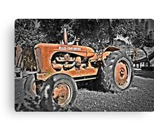 Red tractor rusting away  Canvas Print
