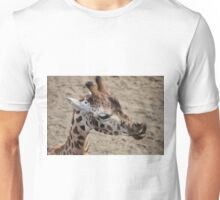 A giraffe licking it's lips Unisex T-Shirt