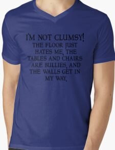 I'm not clumsy. The floor just hates me, the tables and chairs are bullies, and the walls get in my way. Mens V-Neck T-Shirt