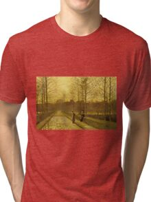 John Atkinson Grimshaw - In The Golden Gloaming. Street landscape: city view, streets, building, houses, prospects, cityscape, architecture, roads, travel landmarks, panorama garden, buildings Tri-blend T-Shirt