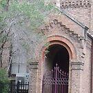 Church doorway. by Judy Woodman