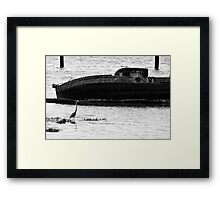 The heron and the boat Framed Print