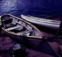 Old wooden boats at night art photo print by ArtNudePhotos