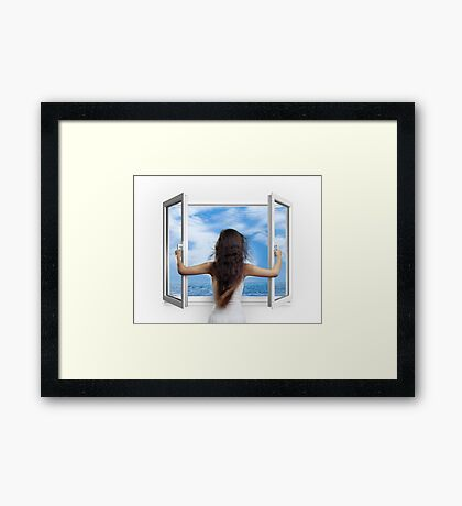 Woman opening window with view on sea art photo print Framed Print