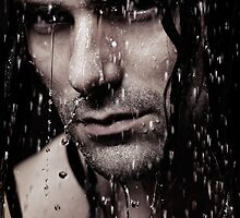 Dramatic portrait of young man wet face with long hair art photo print by ArtNudePhotos