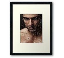Thoughtful man face under pouring water art photo print Framed Print