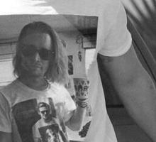 Ryan Gosling wearing aT-shirt of Macaulay Caulkin wearing a T-shirt of Ryan Gosling  Sticker