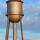 Metal Water Tower and Morning Sky by Kenneth Keifer