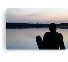Man on the pier watching the sunset Canvas Print