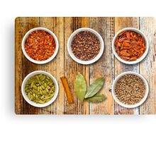 Spices in Pots on a Distressed Wooden Board Canvas Print