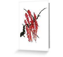 A branch of a blossoming cherry. Red flowers of sakura Greeting Card